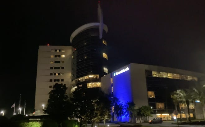 AdventHealth Daytona Beach lit up blue in remembrance of 1st COVID patient, those who died from the pandemic.