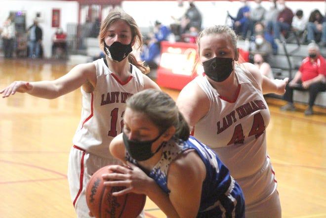 Tekonsha's Carissa Shedd (12) and Emily Davis (44) battle for a loose ball versus Battle Creek Academy Monday night.