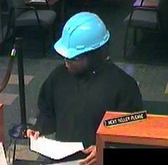 The suspect later identified as Ronald Lomax Jr. is caught on surveilance video wearing a light blue hard hat while robbing the Northwest Bank branch at 3407 Liberty St. on Nov. 21, 2018. Lomax pleaded guilty on Tuesday to robbing the bank twice, with the other holdup occurring five weeks later.