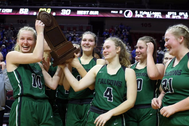 West Burlington High School's players with their participation trophy following their 52-30 Class 3A quarterfinal state tournament loss to West Lyon High School, Monday March 1, 2021 at the Wells Fargo Arena in Des Moines.