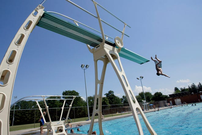 A swimmer flips off the diving boards at Dankwardt pool in Burlington. New diving boards will be a part of the Dankwardt Pool improvement project.