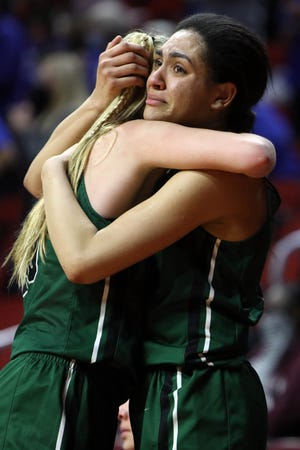West Burlington High School's Annaka Harris (2) hugs teammate Sydney Marlow (10) following their 52-30 Class 3A quarterfinal state tournament loss to West Lyon High School, Monday March 1, 2021 at the Wells Fargo Arena in Des Moines.