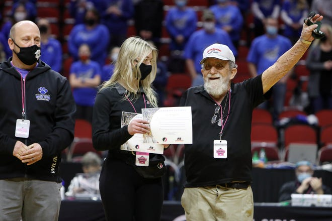 West Burlington High School fan Lee Boughton is recognized before the start of their Class 3A quarterfinal state tournament basketball game against West Lyon High School, Monday March 1, 2021 at the Wells Fargo Arena in Des Moines. West Burlington lost 52-30.