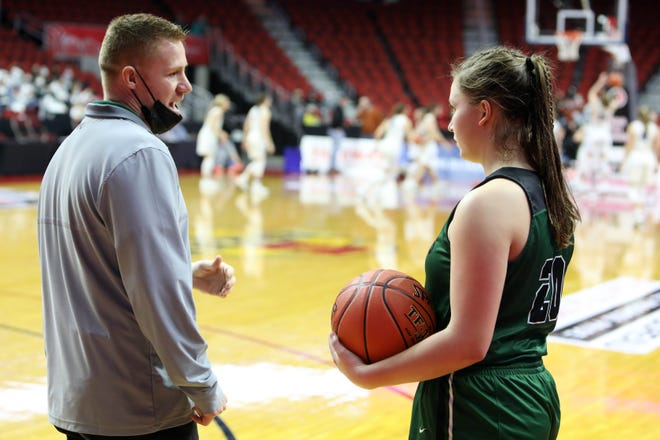 West Burlington High School's assistant coach Brendon Freeman talks with Abbey Bence (20) during their Class 3A quarterfinal state tournament basketball game against West Lyon High School, Monday March 1, 2021 at the Wells Fargo Arena in Des Moines. West Burlington lost 52-30.