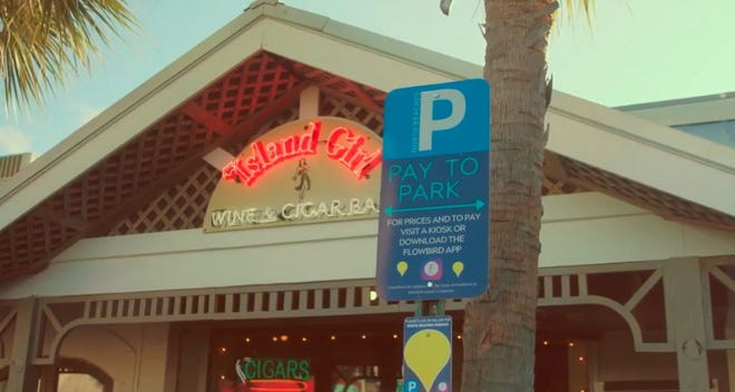 Pay to Park signs mark the Beaches Town Center area of Atlantic and Neptune beaches
