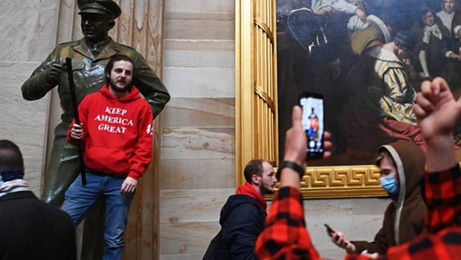 Supporters of President Donald Trump, allegedly including Grayson Sherrill, of Cherryville, enter the U.S. Capitol's Rotunda on Jan. 6, 2021, in Washington, DC. Demonstrators breeched security and entered the Capitol as Congress debated the a 2020 presidential election Electoral Vote Certification. (PHOTO PROVIDED BY THE FBI via SAUL LOEB/AFP via Getty Images)