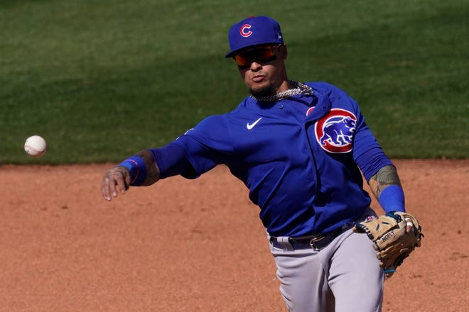 Chicago Cubs shortstop Javier Baez throws during a spring training game against the San Diego Padres on Monday in Peoria, Ariz.