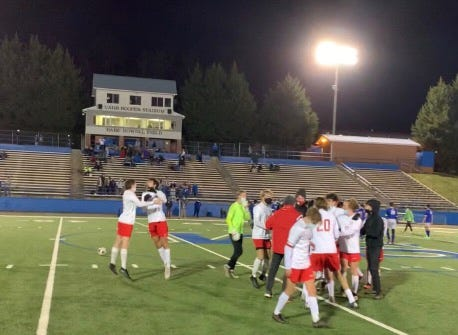 The Hendersonville Bearcat soccer team celebrates its 4-3 overtime win on Monday night at Smoky Mountain.