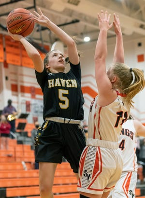Haven's Reese Roper (5) shoots past the arms of Smoky Valley's Keira Mullen (14) during their Class 3A Sub-State quarterfinal game in Lindsborg Monday night. Haven defeated Smoky Valley 41-32. Roper was the team's high scorer with 17 points. Haven will advance and play Halstead Thursday night at 5:30 pm in Hesston.