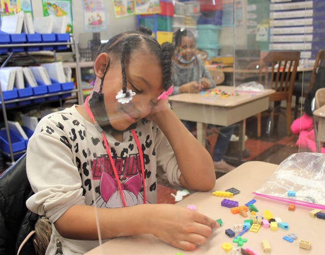 Alivia Hull, a first-grade student at Preston Elementary School, works with Legos at her desk. Alivia was on a mask break while she worked with her Legos. The Richardson Elementary School PTO is collecting new and used Legos and Duplos to provide to all six elementary buildings.