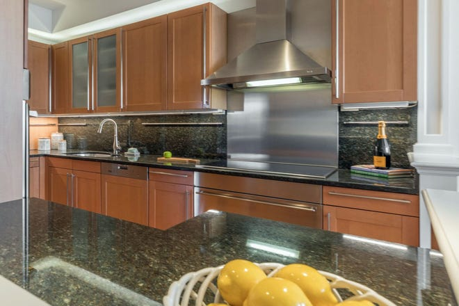 Equipped with top-of-the-line appliances from Sub-Zero, Miele, Wolf, and Thermador, and lined with maple-stained cabinetry, the kitchen will delight a home chef.