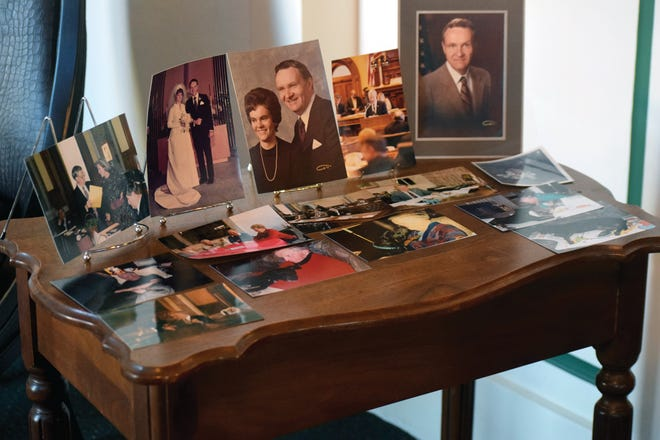Photographs of Clyde Graeber are on display Tuesday at Davis Funeral Chapel for a memorial service. Graeber died Feb. 21 at the age of 87.