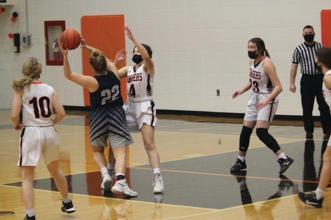 Macomb's Makenna Lefebvre defends during Monday's game against Monmouth-Roseville.
