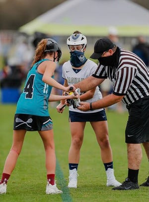 Sophia Pyne takes a faceoff for Academy of the Holy Names during a recent preseason tournament.