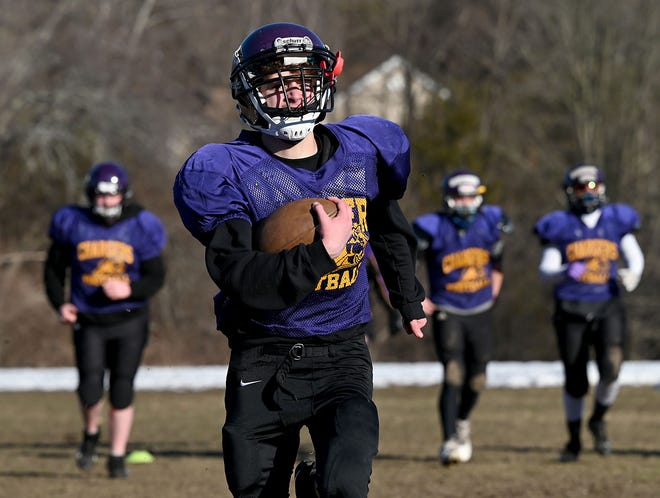 Marcus Waldo of Hopedale runs with the ball during BMR-Hopedale football practice at Blackstone-Millville Regional High School, March 2, 2021.