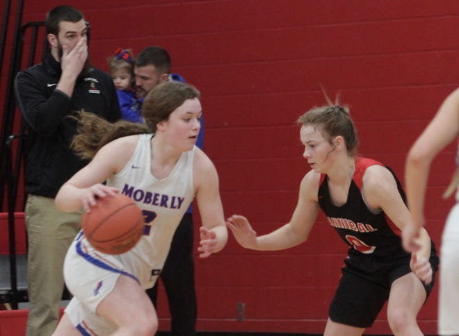 Moberly freshman Grace Billington (with ball) and the Lady Spartans basketball team had their 2020-21 season come to an end Monday with a 58-33 loss to Mexico in a semifinal game of the Class 5 District 15 tournament. Billington scored six points.