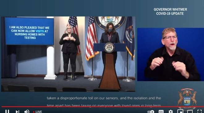 Michigan Gov. Gretchen Whitmer, at center, speaks during the March 2 press conference. This is a screen image from the livestream video.