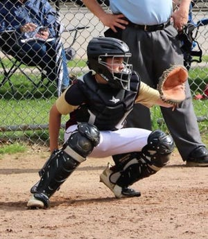 Cameron Ayotte is catcher for Millbury High's Woolies