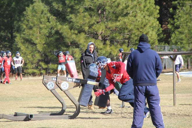 Members of the College of the Siskiyous football team during a drill at COS Friday in Weed.