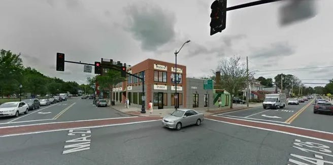 An architectural rendering of a proposed two-story building at the corner of South Main and West Central streets in downtown Natick.