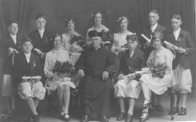 There were nearly a dozen parochial elementary schools in Utica and vicinity in the 1920s and one was the Church of the Sacred Heart School at Ann Street and Ney Avenue. Posing for its 1928 graduating class were: Top row – Wilfred Sawyer, Gordon Senneth, Theona Parker, Marion Warner, Helen Hart, Stanley Jones and Eugene King. Sitting – William Servatius, Margaret Dinneen, the Rev. Patrick J. Sloan, William Waterman and Elsie DeLaire.