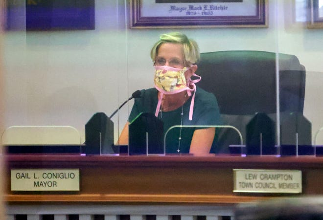 Town of Palm Beach Mayor Gail Coniglio participates in Tuesday's council meeting behind protective partitions.