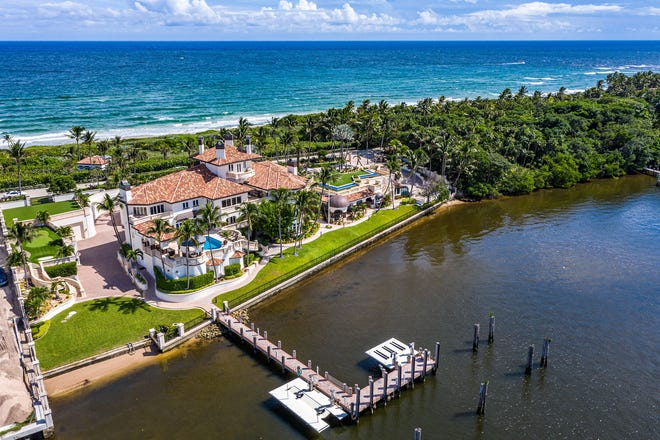 An ocean-to-lake mansion at 1960 S. Ocean Blvd. in Manalapan has sold for $20.45 million, the price recorded Tuesday with the deed. The Ziff family's massive estate next door can be seen at the right.