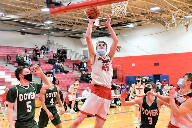 Spaulding's Mark Frost, center, goes up for two of his 18 points as Dover's Ken Healy, Darian Lopez-Sullivan and Jackson Rutland look on during Division I boys basketball playoff action on Monday in Rochester.