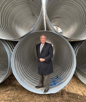 Jim DePetris, CEO of Legend Properties Inc., stands inside a storm drainage pipe that will be installed at the Smithfield Gateway development in Smithfield Township.
