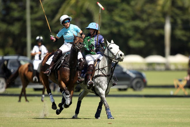 Pamela Flanagan (left) of Hawaii Polo Life and Kylie Sheehan of BTA/The Villages compete during Saturday's U.S. Open Women's Polo Championship at International Polo Club Palm Beach.