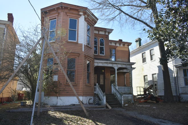 A house on W. Marshall St. is undergoing rehabilitation. This is one of the homes surveyed by volunteers from a citizen blight initiative.