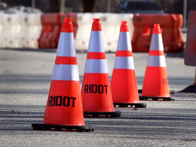 A lineup of traffic cones at McCoy Stadium in Pawtucket. The cones are used for traffic control at the state's drive-thru COVID test sites.