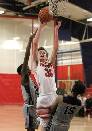 Tim Chlaupek (shown in action from last year) and the Portsmouth boys basketball team kept their hopes as repeating as D-II champions alive with their quarterfinal win over Tolman on Monday.
