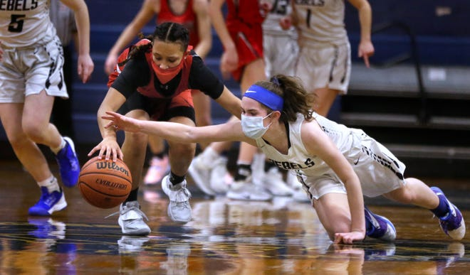 Victoria Hancock, of South Kingstown, tries to steal the ball away from Cranston West's Maylina Santiago during first-half action in their Division I quarterfinal playoff game on Monday. With the varsity team quarantined due to a positive COVID-19 test, the junior varsity stepped up and played the Falcons varsity.