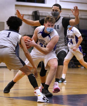 Jack Proctor (with ball) and the Cumberland boys basketball team will play the role of underdog tonight when they travel to Warwick to take on Hendricken in the Division I quarterfinals.
