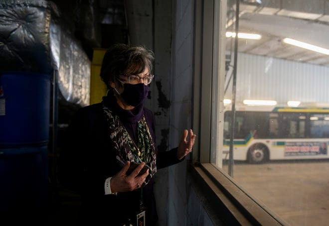 Claudia Amrhein, PARTA general manager, looks into a bay with buses in a garage at the headquarters in Kent.