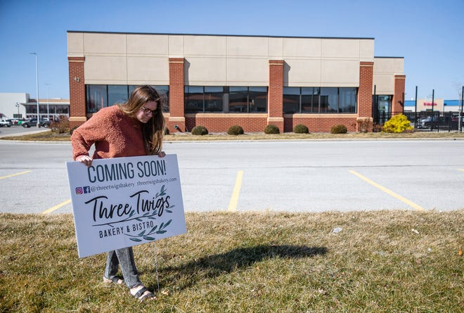 Emily Lewis, owner of Three Twigs, sets up signs outside the former location of Pie's the Limit in Parkway Pointe to let customers know it will be the new location for the bakery and bistro in Springfield, Ill., Tuesday, March 2, 2021. [Justin L. Fowler/The State Journal-Register]