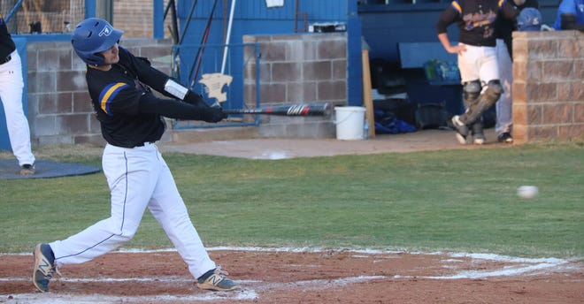 Bethel's Mason Konkler rips a single through the left side of the infield against Lexington Monday night.