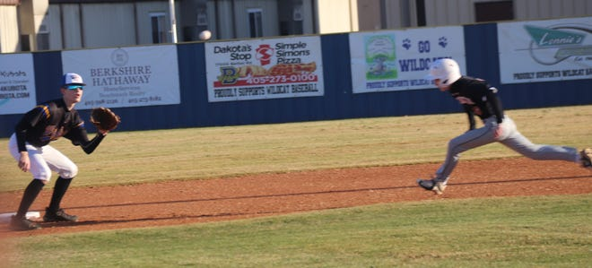 Bethel second baseman RJ Morris (left) takes the throw from catcher Daxton Roberts on a steal attempt Monday. Morris successfully applied the tag for the out.