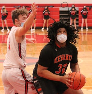 Kewanee's KaZeer Johnson goes up for a shot underneath the basket. He had 18 points and was 8 of 8 from the free-throw line on Saturday.
