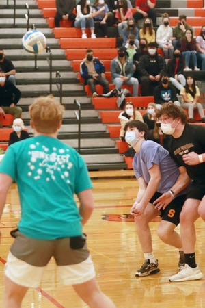 """Sturgis High School seniors converge to return the volleyball back to the underclassmen Friday during the """"Winterfest"""" powderpuff game."""