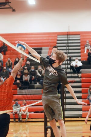 """Jacob German, a Sturgis High School senior, sends the volleyball into the underclassmen's side Friday at the """"Winterfest"""" powderpuff volleyball game."""