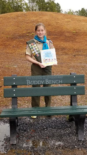 Rachel Webster contributes Buddy Benches to her former elementary school, Creekside Elementary. [CONTRIBUTED PHOTO]