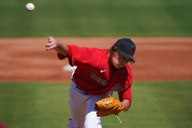Boston Red Sox pitcher Garrett Richards throws in the first inning against the Atlanta Braves on Monday in Fort Myers, Fla.