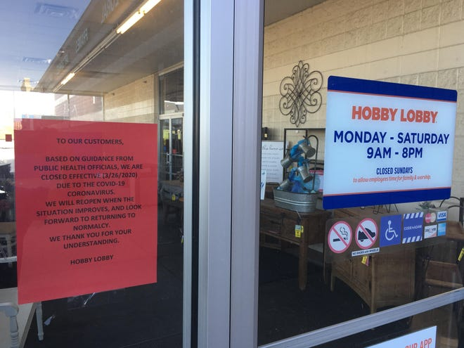 A Hobby Lobby store at Topeka announces its closure in March 2020 due to a county health order stating craft stores are not essential businesses. Such orders, however, would face additional hurdles under a bill the Kansas Senate is pushing.