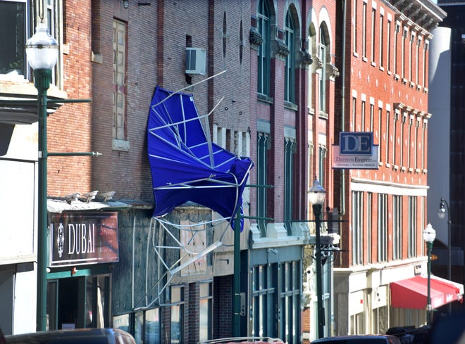 The awning outside Everyday Miracles on Pleasant Street was no match for the high winds Tuesday.