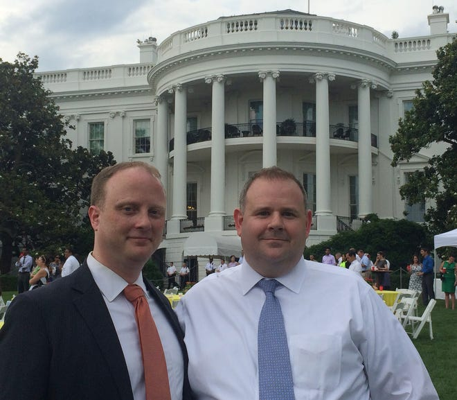 Clinton native Philip McNamara, right, and his husband, Chris Hartmann, on the White House South Lawn in summer 2015.