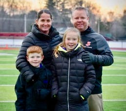 Chris Moriarty shares some family time with his wife, Jillian, and their kids, Jack and Cali, following a game at St. John's.