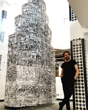 """Artist Kevork Mourad with his """"Seeing Through Babel"""" at Cantor Art Gallery."""