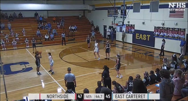 The East Carteret women's basketball team (in white) played the final 48.7 seconds of its 51-45 playoff loss Saturday to Northside with two players because of foul trouble.